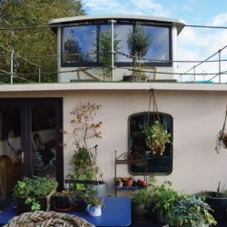 Renovation Project: Converting a Wartime Ammunition Carrier into a Luxury Houseboat